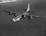 PB4Y-2 Privateer (derived from the PB4Y-1 Liberator) in flight off the eastern shore of Oahu, Hawaii, 1945. Photo 2 of 3.