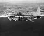 PB4Y-2 Privateer (derived from the PB4Y-1 Liberator) in flight off the eastern shore of Oahu, Hawaii, 1945. Photo 3 of 3.