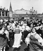 Victory celebration at the Bolshoy Kamenny Bridge near the Kremlin (background), Moscow, Russia, May 1945