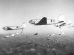 US 187th Regimental Combat Team troops being paradropped from C-46 transport aircraft during a training operation over Korea, date unknown