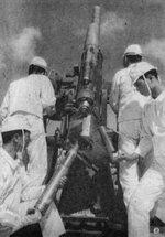 Japanese Navy 8-centimeter Type 3 anti-aircraft gun and crew, date unknown