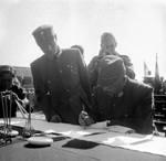 Hiroshi Nemoto signing the surrender document at the Forbidden City, Beiping, China, 10 Oct 1945, photo 2 of 3