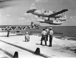 OS2U Kingfisher float plane being shot off a catapult mounted on a dock for training purposes at Pensacola, Florida, United States, pre-war 1941.