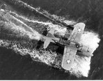 Overhead view of an OS2U Kingfisher underway after making a water landing at NAS Jacksonville, Florida, United States, Mar 1943.