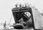 Japanese landing ship No. 149 loading a Type 95 Ha-Go light tank, Nasake Island, Kure, Japan, 27 Feb 1944