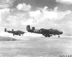 B-25J Mitchell bombers of the 41st Bomb Group armed with Mark XIII torpedoes prepare for take-off from Yonton Airfield, Okinawa bound for an attack on Japanese shipping at Sasebo, Japan, 28 Jul 1945.