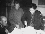 Bai Chongxi and Song Meiling preparing a birthday cake for Chiang Kaishek, Chongqing, China, 31 Oct 1945