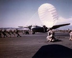 US Marine paratroopers training on handling parachutes in heavy winds, Navy Auxiliary Air Station at Camp Kearny, California (now Miramar), 1942. Note rare R3D aircraft, only 12 such planes were made.