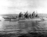 All three battleships of the New Mexico-class, USS Idaho, USS New Mexico, and USS Mississippi, moored abreast at Pearl Harbor, Territory of Hawaii, 17 Dec 1943