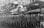 Chinese-American troops on parade for the Veterans Day holiday at the intersection of Tremont Street and Winter Street, Boston, Massachusetts, United States, 11 Nov 1945