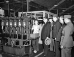 Chinese representatives touring the John Inglis and Company factory, Toronto, Canada, 20 Aug 1943