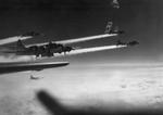 B-17G Fortresses of the US 15th Air Force trailing condensation trails amid anti-aircraft flak bursts during the bombing run over Graz, Austria, 4 Mar 1945.