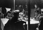 Montgomery reading surrender document to German officers at British 21st Army Group headquarters, Lüneburg Heath, Germany, 4 May 1945. This was only the large surrender in Germany of German forces facing British forces.