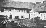Lidice, Czechoslovakia in the 1930s. Courtyard of the Horák family farm. The X marks the entrance to the cellars where the village men were gathered on the night of 9 Jun 1942.