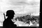 A German sentry overlooking the Pechersk Lavra Monastery and Dnieper River in Kiev, Ukraine, Sep 1941.