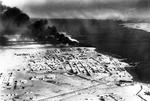 Smoke rising from the port of Tobruk, Libya, 1941.