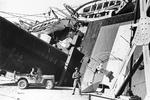 US Army sentry at the partially capsized Vichy-French ocean liner SS Porthos in the harbor at Casablanca, French Morocco, 8 Nov 1942. The Porthos was damaged by 16-inch shells fired from the USS Massachusetts.