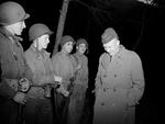 General Dwight Eisenhower sharing a lighter moment with four US Army soldiers in Tunisia, 18 Mar 1943.