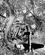 German He 111 bomber in flight northbound over Surrey Docks, London, England, United Kingdom at 1700 hours on 7 Sep 1940, photo 2 of 2
