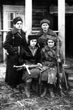 Faye Lazebnik (front row, 1st from right) with fellow resistance fighters of the Molotava Brigade, Poland, 1942-1944