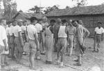 Lieutenant General Joseph Stilwell speaking to Chinese troops at a rehabilitation camp, Assam, India, 15 Jul 1944