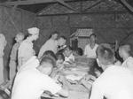 Lieutenant General Joseph Stilwell observing leather work class attended by wounded Chinese soldiers at a rehabilitation center along the Ledo Road in Assam, India, 15 Jul 1944