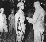 Lieutenant General Joseph Stilwell awarding a Silver Star medal to a Chinese soldier in the field, about six miles south of Laban, northern Burma, 28 Apr 1944