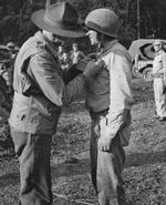 Lieutenant General Joseph Stilwell awarding the Silver Star medal to Lieutenant Albert J. Harvey, Hukawng Valley, northern Burma, 18 Mar 1944