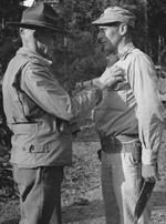 Lieutenant General Joseph Stilwell awarding the Silver Star medal to Colonel Rothwell H. Brown, Hukawng Valley, northern Burma, 18 Mar 1944
