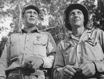 Colonel Rothwell Brown and 2nd Lieutenant Albert Harvey shortly after receiving Silver Star medals from Major General Joseph Stilwell, Hukawng Valley, northern Burma, 18 Mar 1944