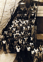 Crew of USS Oahu at prayer upon hearing the news of Japanese surrender, Eniwetok Atoll, Marshall Islands, 15 Aug 1945
