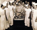 Commander A. M. Loker celebrating victory with cake aboard USS Oahu while at Eniwetok, Marshall Islands, 15 Aug 1945