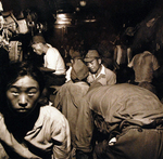 Demobilized Japanese soldiers and civilians aboard a train in Hiroshima, Japan, Sep 1945