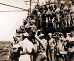 A Japanese officer being transported aboard USS Missouri in a boatswain