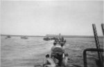 PT-114 and other PT Boats of Motor Torpedo Boat Squadron 6 (MTBRon 6) on patrol in the Solomon Islands or the New Guinea area, 1942-43. Note twin Browning M2 .50 caliber machine guns in foreground.