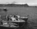 Higgins 78-foot torpedo boats of Motor Torpedo Boat Squadron 13 (MTBRon 13) moored in Attu, Alaska, Jul 943. Note PT-75 and PT-78 nested outboard of their squadron-mate and PBY Catalina patrol plane taking off.