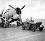 A Jeep on the deck of the USS Yorktown (Essex-class) being used as an aircraft tug during the strikes on Wake Island, 5 Oct 1943. In this case, the Jeep is being hooked to a TBM-1C Avenger.