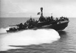 Elco 80-foot torpedo boat PT-122 traveling at speed, 1944-45. Note Mark XIII aerial torpedoes in their racks have replaced the heavy steel torpedo tubes allowing for Bofors 40mm gun aft and 37mm cannon forward.
