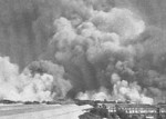 Smoke rising from Victoria Dock, Bombay, India during the cargo ship Fort Stikine explosion, 14 Apr 1944