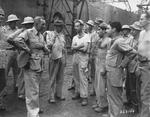 Brigadier General Gilbert Cheves and Lieutenant General Joseph Stilwell speaking with non-commissioned officers, Calcutta, India, 30 Jul 1944