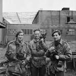 British Army photographers Sergeant Dennis M. Smith, Sergeant G. Walker, and Sergeant C. M. Lewis at Pinewood Studios, Iver Heath, Buckinghamshire, England, United Kingdom, late Sep 1944