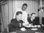 African-American steward serving Caucasian-American officers aboard a US destroyer, Londonderry, Northern Ireland, United Kingdom, Jan 1942
