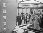 Wife of Vice Admiral V. H. Godfrey launching a newly constructed sloop for the Indian Navy, HMIS Kistna, at Yarrows Yard, Clydebank, Scotland, United Kingdom, 22 Apr 1943
