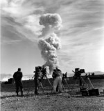 Leslie Elliott (center) filming the Upshot-Knothole Grable atomic test, Nevada Test Site, Nevada, United States, 25 May 1953