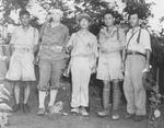Lieutenant General Joseph Stilwell (second from left) and Lieutenant General Hu Su (center) at Myitkyina, Burma, 18 Jul 1944