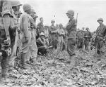 Lieutenant General Joseph Stilwell speaking with US and Chinese officers, Myitkyina, Burma, 18 Jul 1944, photo 1 of 2