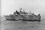 "PT-170, an Elco 80-footer of Motor Torpedo Boat Squadron 10 (MTBRon 10), painted in ""zebra"" pattern designed to thwart enemy optical range finding, 1942. Photo 1 of 2"
