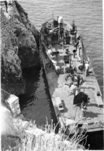 PT-215, a Higgins 78-footer of Motor Torpedo Boat Squadron 15 (MTBRon 15), tied up in Blue Grotto, Capri, Italy in Mar 1944.