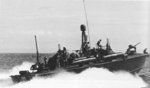 PT-330, an Elco 80-footer of Motor Torpedo Boat Squadron 21 (MTBRon 21), underway in the Philippines, circa 1945. Note the smoke generator canister on the stern.
