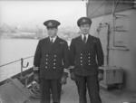 Norwegian destroyer HNoMS Stord's commanding officer LtCdr Skule Storheill (left) and his first lieutenant Lt T. Holthe aboard the Stord in Rosyth harbor, Scotland, United Kingdom, 4 Jan 1944